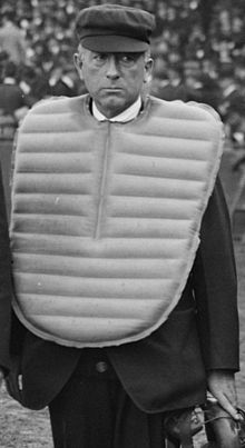 Umpire Bill Connolly wears balloon chest protector and plate coat