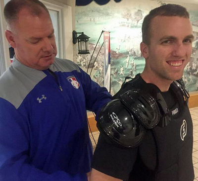 Scott fits a student for a Force3 chest protector