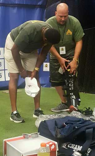 Instructor shows student how to fit umpire shin guards